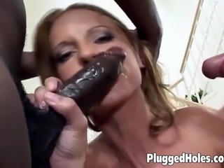 Busty tattooed slut getting fucked by massive dildos and two cocks