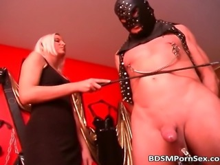 Two mistresses punish their slave.