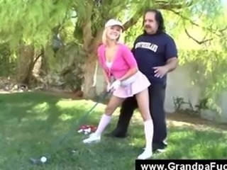 Grandpa goes down on blondy golf style