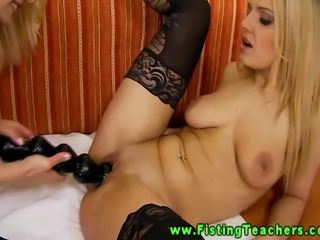 Blonde lesbo inserts big dildo in her girlfriends pussy
