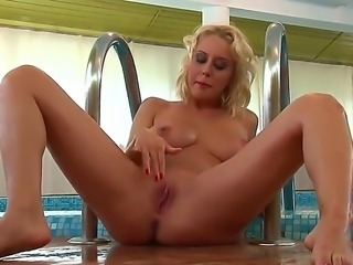 Sweet blonde Mandi Dee is relieving her lusty urges at the pool side by...