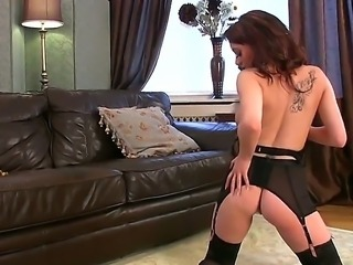 Beautiful brunette Danielle undresses her bra and masturbates with the...