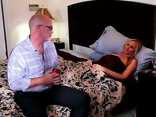 Julia Ann is laying in her bed and James Deen is seducing her for some hot...