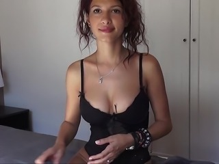 Flirty girl with perky natural tits spreading on a webcam