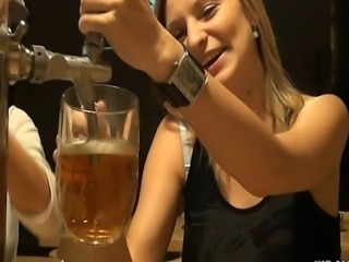 Very joyful girl is drinking beer and then goes to toilet, where she is...
