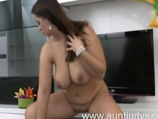Mature housewife Sirale teases with her feet giving several upskirt shots of...