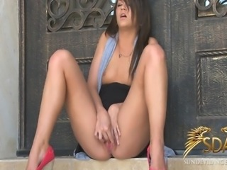 Watch 18 year old Kristin Masturbate outside until she cums real hard to a...