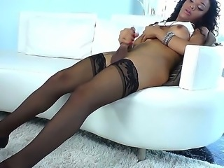 Black and exquisite shemale Nicole Starr is feeling bored so she decides its...