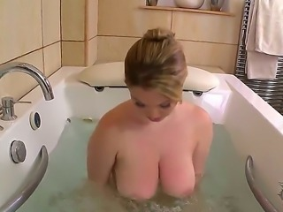 Hot lady Lyla Ashby is taking a bath and her gigantic breasts are almost...