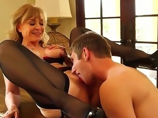 Mature bitch Nina Hartley put on her sexiest clothes with stocking and high...