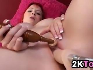 Beautiful redhead masturbates with her toy and her machine