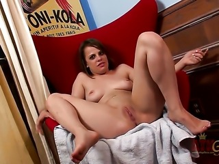 Brunette sex kitten with big jugs and clean twat getting down all by herself
