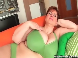 Aged BBW with massive boobs fucks a long dildo free