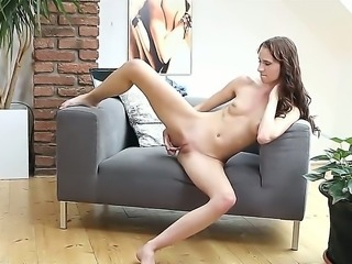 Lida is a skinny girl caught masturbating on her couch. But she is so into it...