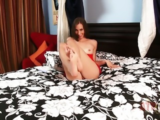 Brunette porn diva Aiyana Flora demonstrates her private parts before she...