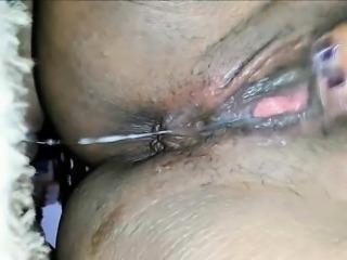 Black MILF mastubates and squirts closeup