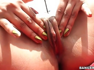 Redhead Dawn Taylor masturbates and blows by the pool