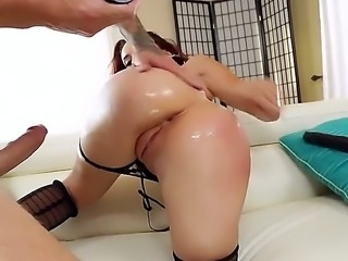 Adorable redhead is licking the guys balls and ass. She is in turn getting a...