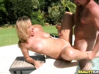 Blonde with gigantic breasts and bald bush has fire in her eyes as she gets...
