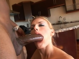 Horny blonde takes a big black cock up her ass