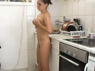 Strap-on dildo lesbian fun in the kitchen at night