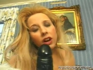 Kinky college blonde sucks huge black dildo and masturbates pussy outdoor