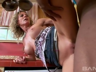 Jade Jamison is getting her pussy licked on the kitchen counter