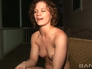Two naked slutty hotties smoke on the balcony and talk