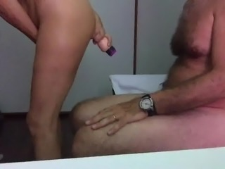 Inserting pink dildo in ass