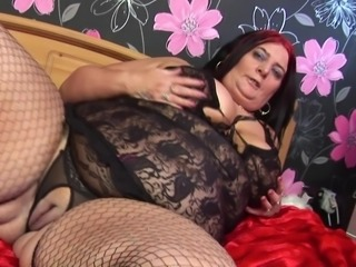 Attractive matured granny in fishnet stockings masturbating indoors
