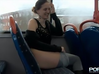 Amateur dark haired chick flashes her bum and pisses in the public bus