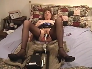 Matured cowgirl in nylon stockings getting the pleasure of massive sex machine