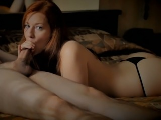 Mesmerizing redhead pale skin beauty topless sucks dick