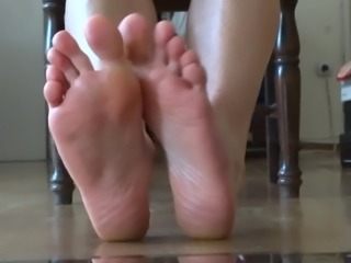 Foot fetish in the mirror - showing the bottom of my soles