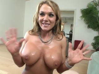 Pornstar with fake tits displaying her nice ass before giving big cock blowjob