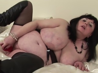 Fat mature tart Deanna rides hard on a huge red dildo