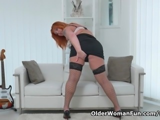 Redhead milf Alex strips off and fingers her mature pussy