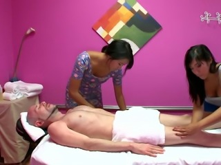 Lusty Asian bitches give a head to white stud in massage parlor