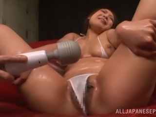 Busty siren gets oiled up and vibrated in her bushy beaver