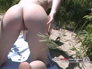 Bikini babe learning football then masturbates on beach