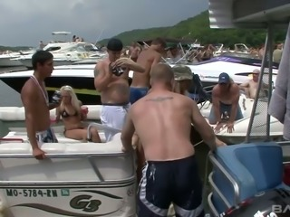 Sexalicious girls parting topless on a boat