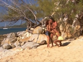Sahara and Leanna treat a fellow to a threesome on a beach