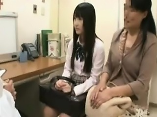 Beautiful Oriental girl has a doctor examining her big natu