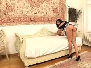 Gorgeous brunette in slutty housemaid outfit fucked on the couch