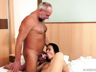 Brunette with huge jugs gets down on her knees to be skull fucked