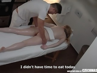 Beautiful Young Girl Spreding her Lengs on Massage Table