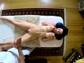 Buxom black haired mommy gets her anus fisted by horny massage man