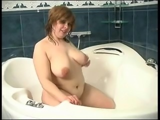chubby mature in the shower