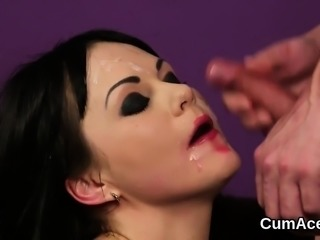 Flirty doll gets cum shot on her face eating all the load