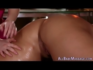 Masseuse strokes pussy